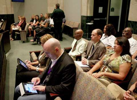 Spectators and media wait in the courtroom as the jury deliberates in the Casey Anthony murder trial in Orlando, Fla., Tuesday, July 5, 2011. It is the second day of jury deliberations. Anthony has pleaded not guilty to first-degree murder in the death of her daughter, Caylee, and could face the death penalty if convicted of that charge. Photo: AP