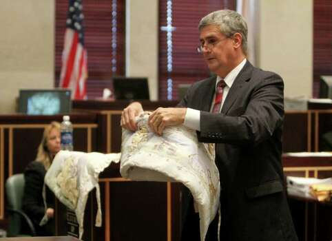 Assistant state attorney Jeff Ashton shows bedding that match a blanket found with the remains of Caylee Anthony, during closing arguments in the Casey Anthony murder trial in Orlando, Fla., Sunday, July 3, 2011. Casey Anthony has plead not guilty to first-degree murder in the death of her daughter, Caylee, and could face the death penalty if convicted of that charge. (AP Photo/Red Huber, Pool) Photo: Red Huber