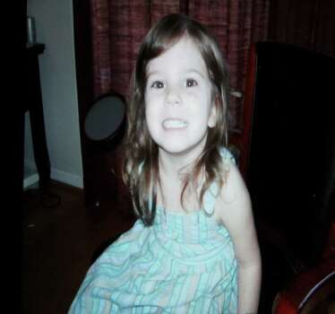 A photograph, of Caylee Anthony is displayed on a monitor after being entered into evidence during day 18 of the Casey Anthony murder trial at the Orange County Courthouse, in Orlando, Fla., Tuesday, June 14, 2011.  Anthony, 25,  is charged with killing her 2-year old daughter, Caylee, in 2008. Photo: AP