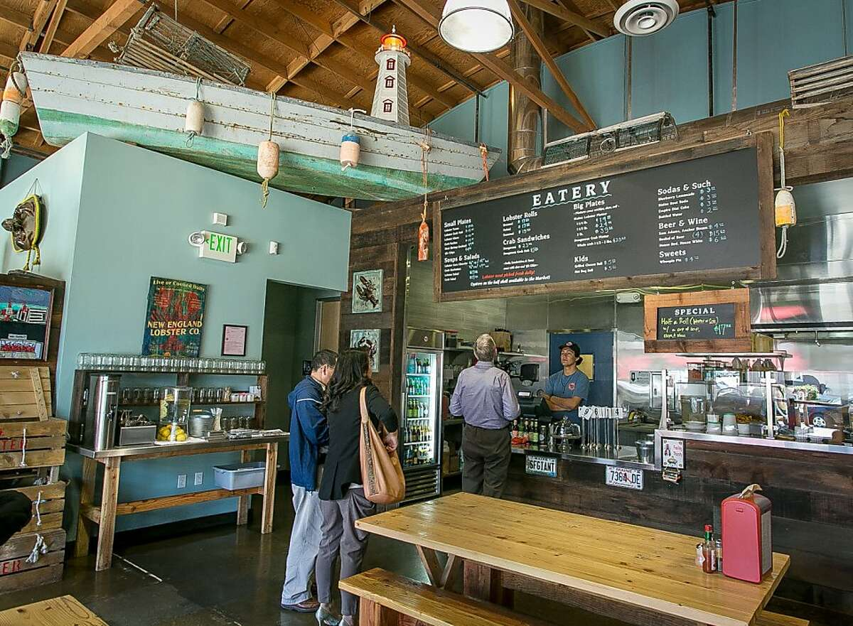 People order from the chalk board menu at the New England Lobster Company in Burlingame, Calif., on Tuesday, April 30th, 2012.