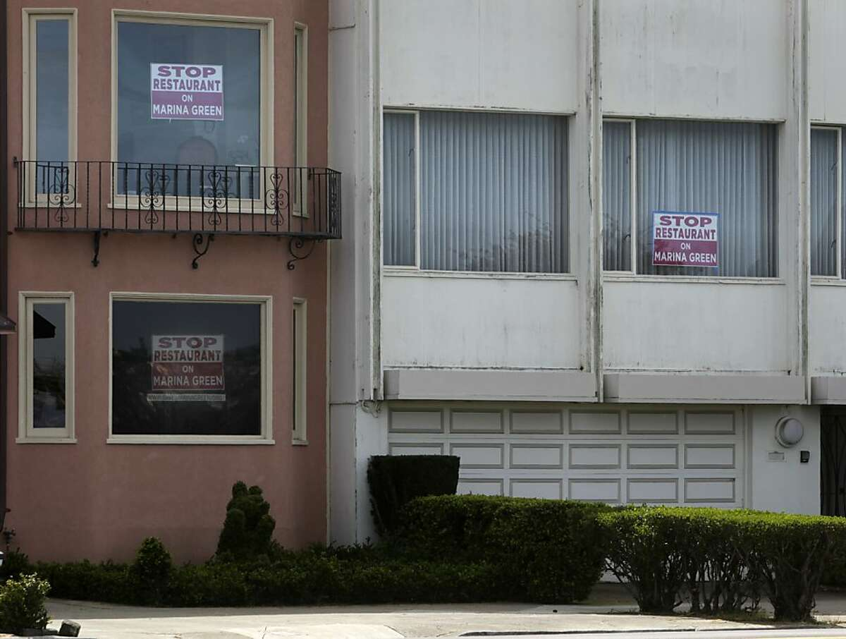 Residents on Marina Boulevard display their opposition to a proposed restaurant at the site of the old Naval magnetic range house on the Marina Green in San Francisco, Calif. on Tuesday, March 26, 2013, where restaurateur Dylan MacNiven hopes to open one of his Woodhouse Fish Co. eateries.