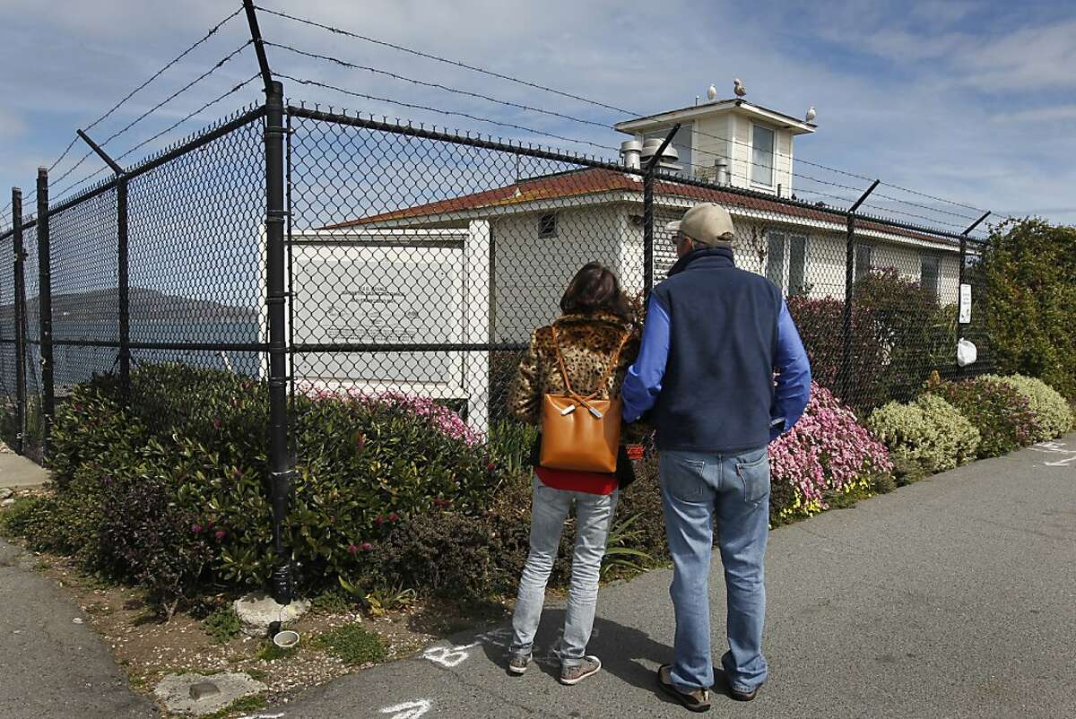 """Pamela and Kent Russell stop to view the old Naval magnetic range house on the Marina Green in San Francisco, Calif. on Tuesday, March 26, 2013. The Russells think """"it's a fabulous idea"""" to open an eatery at the site, where restaurateur Dylan MacNiven hopes to open one of his Woodhouse Fish Co. restaurants, but the plans have been met with opposition from nearby residents."""