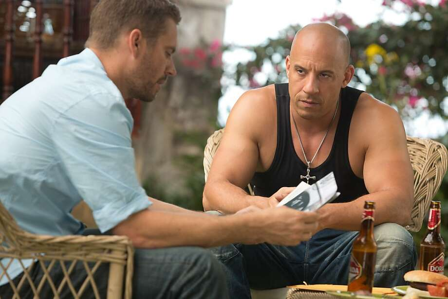 Dominic Teretto (Vin Diesel) and Brian O'Conner (Paul Walker) contemplate taking down a criminal mastermind in exchange for full pardons In 'Fast and Furious 6.' Photo: Universal Pictures 2013
