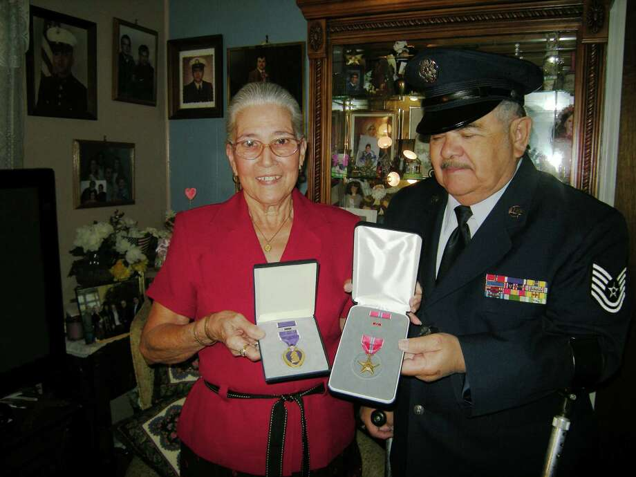 Placido Salazar holds his Bronze Star Medal while his wife, Maria, holds the Purple Heart Medal. The Universal City resident received both in an April 27 ceremony. Photo: Wanda Littles / For The NE Herald