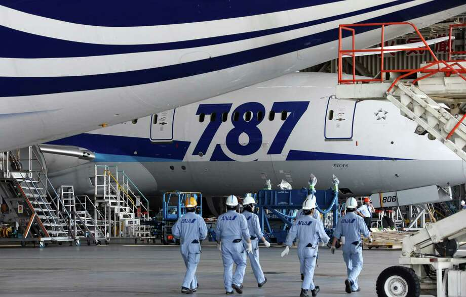 An All Nippon Airways Boeing 787 awaits its return to the air last month in a hangar at Tokyo's Haneda Airport. All Nippon and other carriers that fly the Dreamliner, including United, are returning them to service. Photo: Tomohiro Ohsumi / ゥ 2013 Bloomberg Finance LP