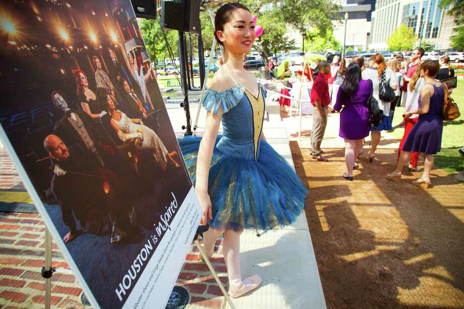 """Dancer Haruka Sassa attends the """"Houston Is Inspired"""" campaign news conference Tuesday, May 7, 2013, in Houston. Artist GONZO247 unveiled his """"Houston Is"""" mural at the corner of Preston and Travis for the Travel Rally Day news conference. Photo: Brett Coomer, Houston Chronicle / © 2013 Houston Chronicle"""