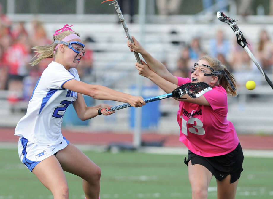 At left, Hollis Perticone (#29) of Darien scores during the second half while being covered by Jenny Goggin (# 13) of Greenwich during the girls high school lacrosse match between Darien High School and Greenwich High School at Darien, Tuesday afternoon, May 7, 2013. Darien won the match 17-9. Photo: Bob Luckey / Greenwich Time