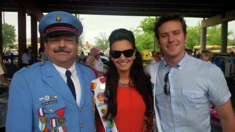 Hot Hollywood couple Elizabeth Chambers and Armie Hammer with Arthur Cavazos at Battle of Flowers Parade.
