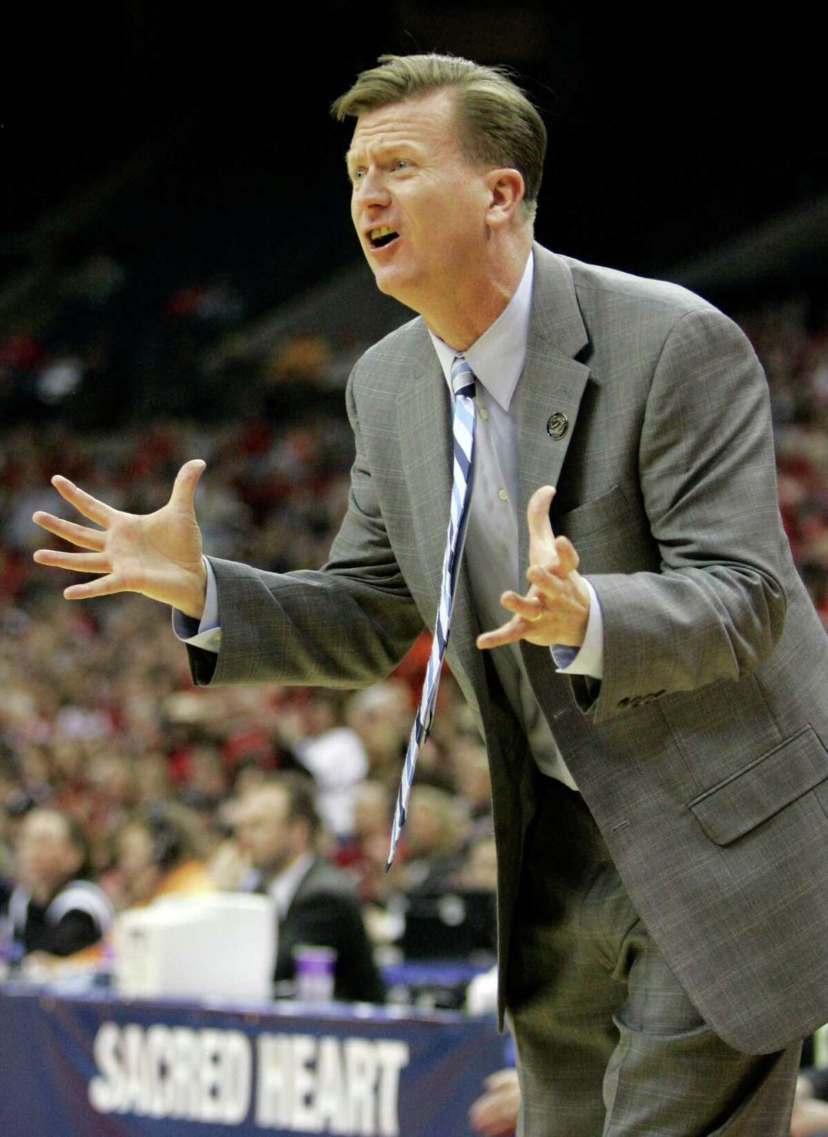 Sacred Heart coach Ed Swanson directs his team during a first-round women's NCAA college basketball tournament game against Ohio State Saturday, March 21, 2009 in Columbus, Ohio. (AP Photo/Kiichiro Sato)