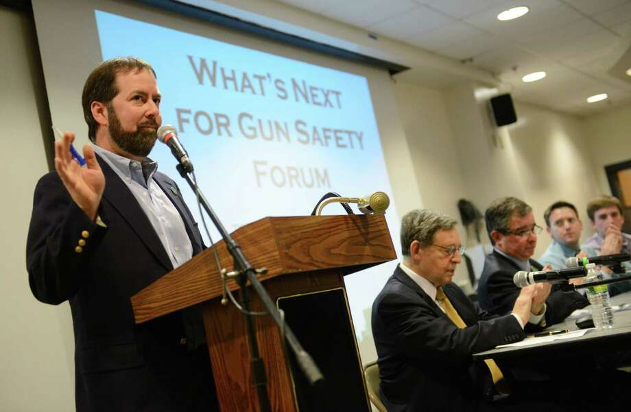 "Newtown Action Alliance Founder Dave Ackert says opening remarks at the ""What's Next for Gun Safety?"" forum with national leaders for gun safety at Newtown High School in Newtown, Conn. on Tuesday, May 7, 2013.  The forum, presented by Newtown Action Alliance, featured National Gun Victims Action Council President Elliot Fineman, Coalition to Stop Gun Violence Executive Director Joshua Horwitz, Virginia Tech shooting survivor Colin Lynam Goddard, Mayors Against Guns Director of Outreach Christopher Kocher, and Aurora movie theater shooting survivor Stephen Barton. Photo: Tyler Sizemore / The News-Times"