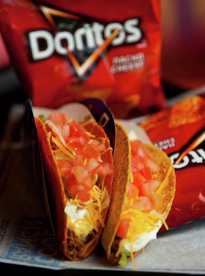 Taco Bell's Doritos Locos Tacos, nacho cheese and cool ranch flavors, Tuesday, May 7, 2013, in Katy. ( Nick de la Torre / Chronicle ) Photo: Nick De La Torre, Staff / © 2013 Houston Chronicle