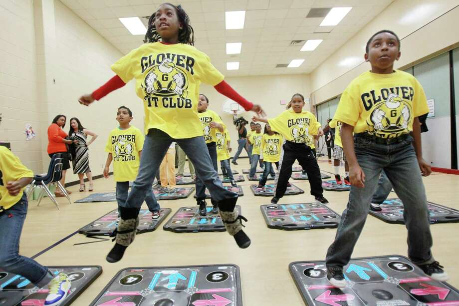Jiamya Jones, 10, leaps as the third grade class showcases the new DanceRevolution Classroom Edition video game. Photo: Mayra Beltran / © 2013 Houston Chronicle
