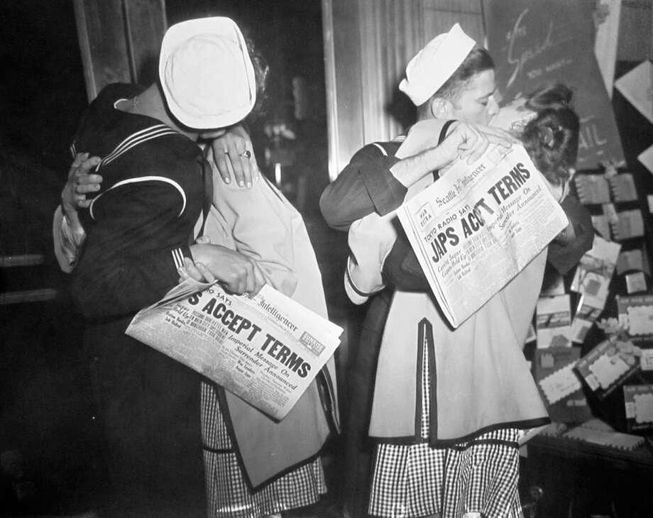 This picture, said to have been taken on Aug. 13, 1945, shows sailors holding copies of the P-I sunrise edition announcing Japan had accepted terms that would end World War II. The negative has been preserved at the Musum of History and Industry since a 1986 P-I donation. Photo: Copyright MOHAI,  Seattle Post-Intelligencer Collection,  PI28300