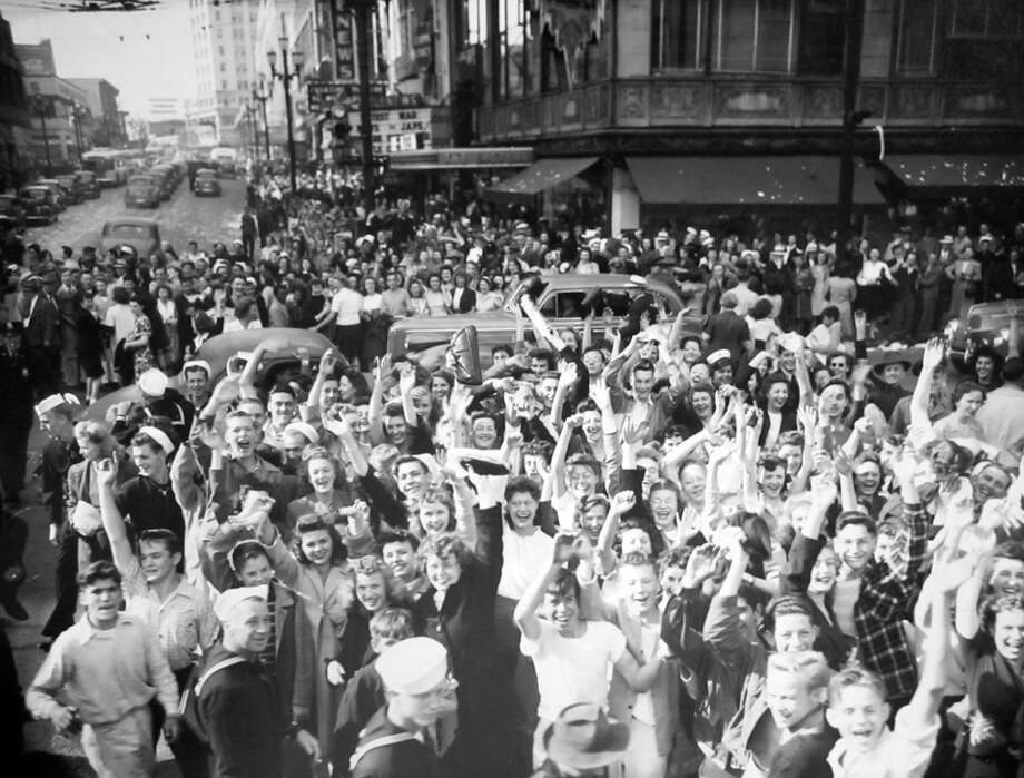 This previously unpublished photo from Aug. 1945, shows crowds celebrating Japan's surrender in World War II. The picture sat in the P-I archive for more than four decades, and has been preserved at the Museum of History and Industry since 1986. Photo: Copyright MOHAI, Seattle Post-Intelligencer Collection, PI28303