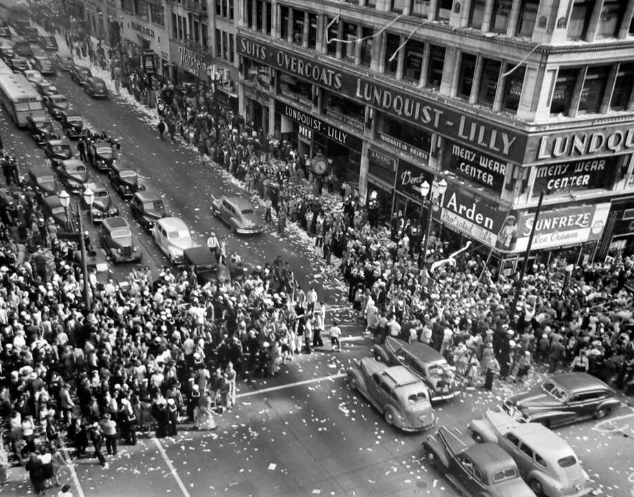 Just after midnight on Aug. 14, 1945, the Seattle Post-Intelligencer hit the streets with the news that the Japanese would accept the allied peace terms. Sirens blared, car horns honked, church bells rang and people danced in the streets to celebrate the end of World War II. This image was taken later that day at Fourth Avenue and Pike Street. Photo: Copyright MOHAI, Seattle Post-Intelligencer Collection, PI28290