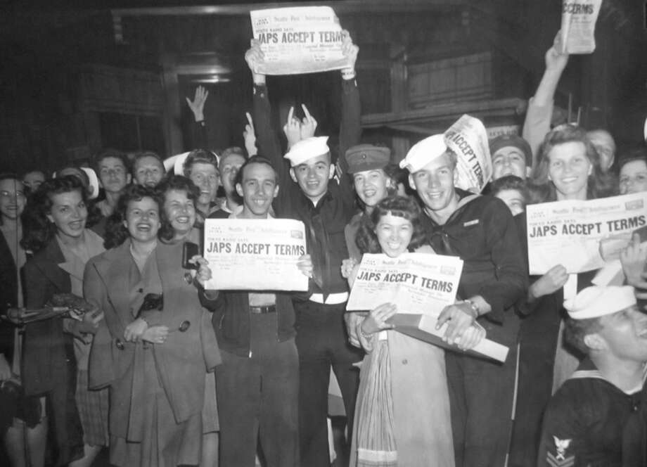 People on the streets of Seattle celebrate Japans surrender, Aug. 1945. Most of the images gathered here have never been published until today. Photo: Copyright MOHAI, Seattle Post-Intelligencer Collection, PI28299