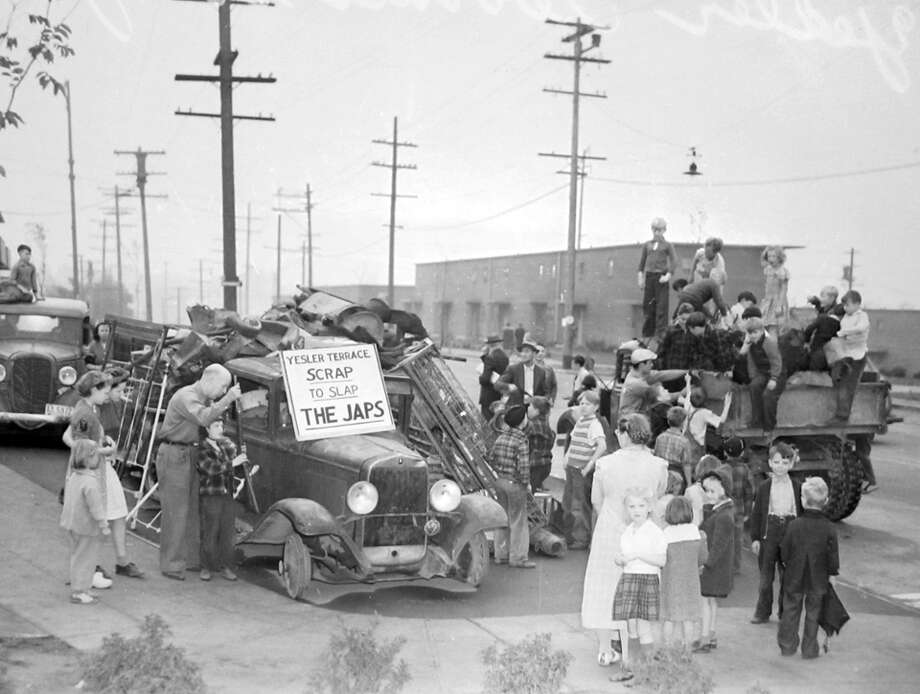 Here's a previously unpublished Oct. 1944 scene in Yesler Terrace showing a scrap metal drive to benefit World War II troops. Photo: Copyright MOHAI, Seattle Post-Intelligencer Collection, PI28169