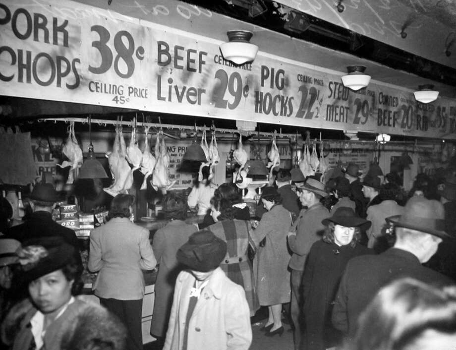A Feb. 20, 1943 scene at the Pike Place Market during a time when there were rations and shortages. This image was not previously published in the P-I. Photo: Copyright MOHAI, Seattle Post-Intelligencer Collection, PI28110