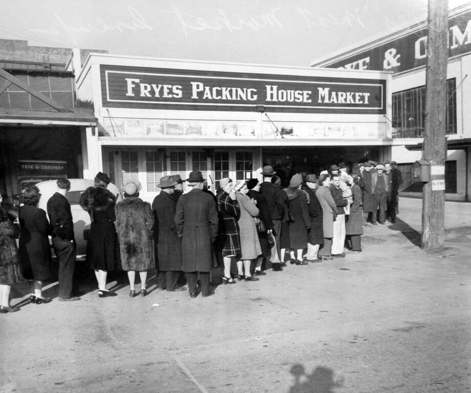 A previously unpublished photo of the Frye & Company Packing House Market taken on March 20, 1943. This scene at 2203 Airport Way was taken just more than a month after a XB-29 prototype Superfortress crashed into the Frye Packing Plant, killing 30 people. Note the photographers shadow in the bottom of this image. Photo: Copyright MOHAI, Seattle Post-Intelligencer Collection, PI28112