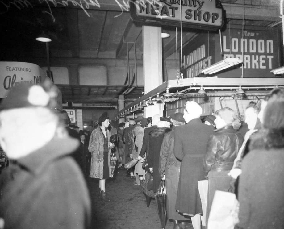 A previously unpublished scene at the New London Meat Market in Seattle, April 3, 1943. The market was at 1928 Third Avenue in Seattle. Photo: Copyright MOHAI, Seattle Post-Intelligencer Collection, PI28114