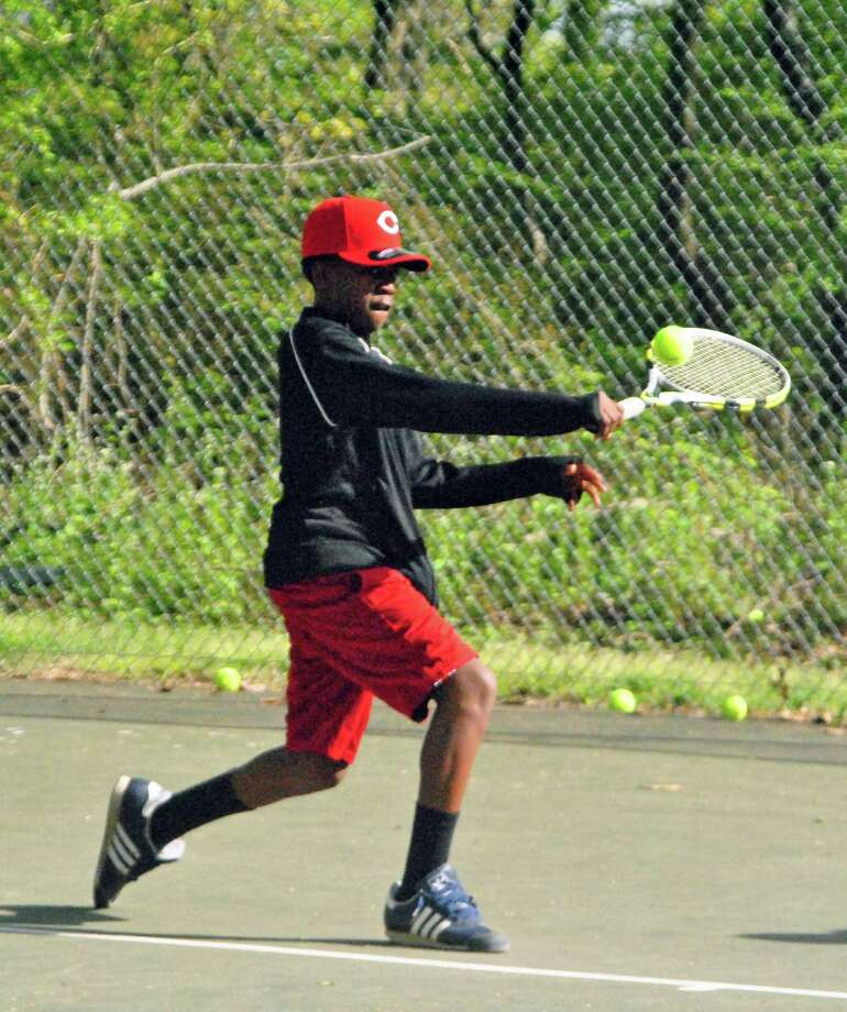 Armani Sawyer approaches a backhand slice Tuesday at Roodner Court with Norwalk Grassroots Tennis. Photo: Jordan Osterhout / For The Norwa