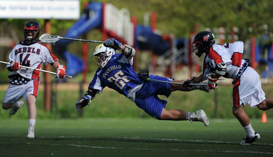 Brookfield's Dane Heckmann flies through the air after scoring a goal during New Fairfield's 15-12 win over Brookfield at New Fairfield High School in New Fairfield, Conn. on Tuesday, May 7, 2013. Photo: Tyler Sizemore / The News-Times