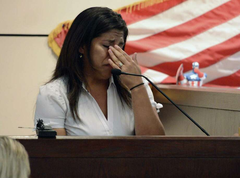 Homeowner Yvette Espinoza wipes her eyes as she testifies. After the shooting, she didn't realize she'd been wounded.