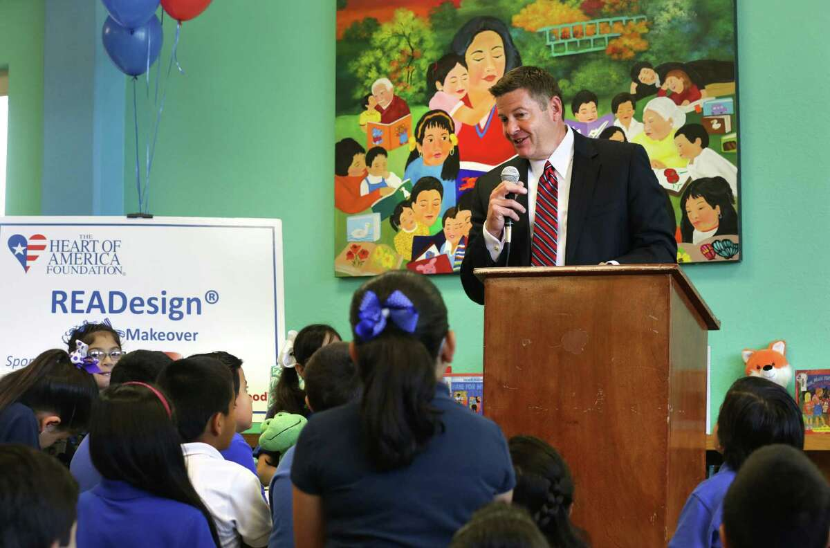 Kent Eastman, State President of Capital One Bank for Texas, speaks to students at Rodriguez Elementary School as they celebrated the renovation of the school's redesigned library through a grant from Capital One Bank on Tuesday May 7, 2013.
