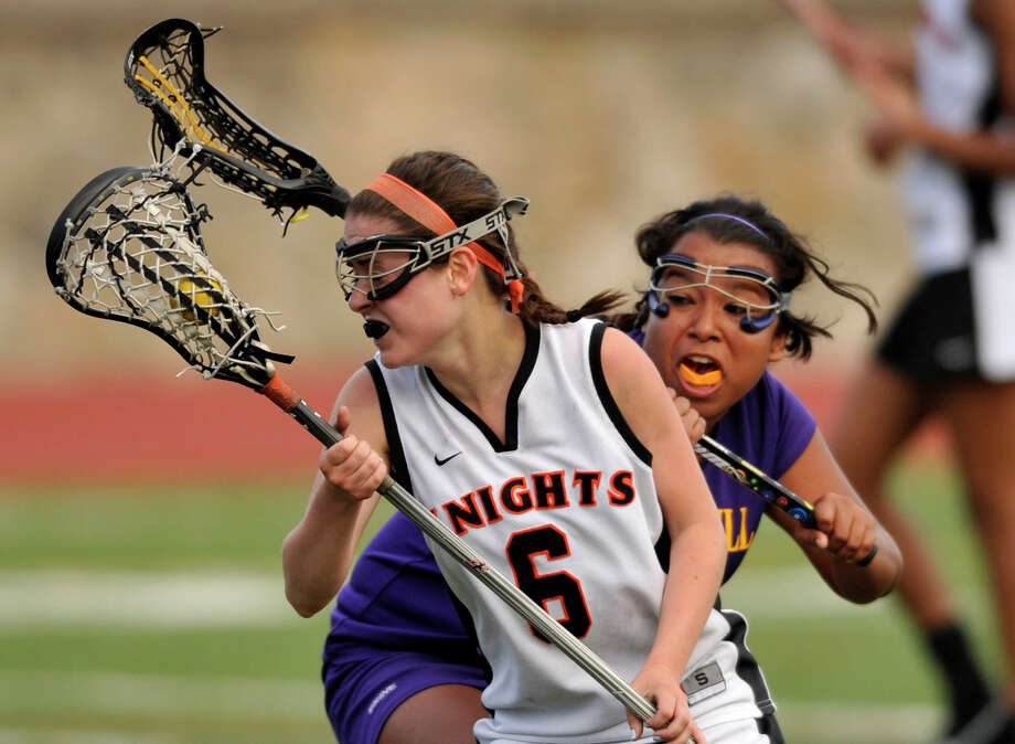 Stamford's Lindsey Colandro changes direction on Westhill's Heide Hernandez during their game at Stamford High School on Tuesday, May 7, 2013. Stamford won, 14-3. Photo: Jason Rearick / Stamford Advocate