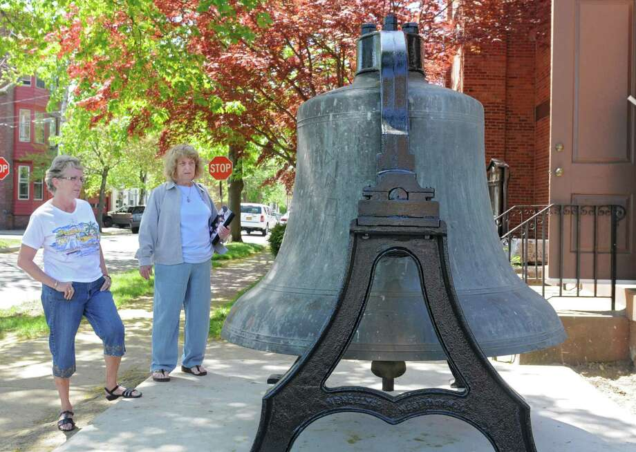 Peggy Germano, left, and Marylou Ragosta look at the bell from St. Patrick's Church which is on display in front of the Watervliet Historical Society Museum on Tuesday, May 7, 2013 in Watervliet, N.Y. Both ladies are from Watervliet and are members of the Watervliet Historical Society. The over 7000 pound bell was cast in 1906 at Meneely & Co. which used to be just across the street from this museum. (Lori Van Buren / Times Union) Photo: Lori Van Buren / 10022286A