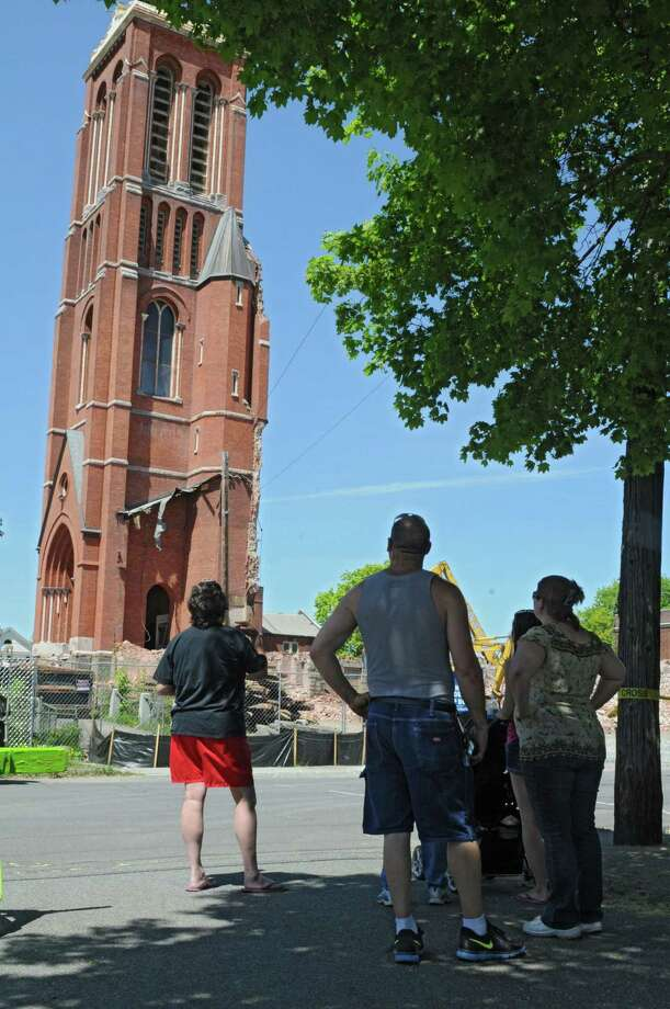 Onlookers watch as demolition continues on St. Patrick's Church on Tuesday, May 7, 2013 in Watervliet, N.Y. (Lori Van Buren / Times Union) Photo: Lori Van Buren / 10022286A