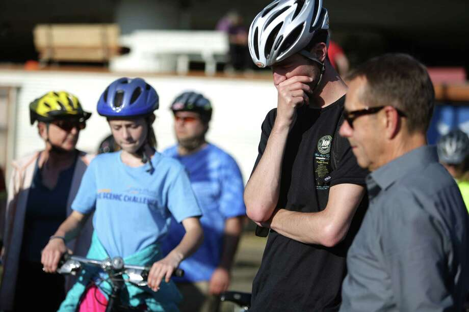 People bow their heads during a memorial bike ride for Lance David, a cyclist killed in an accident with a semi-truck on East Marginal Way South. Photo: JOSHUA TRUJILLO, SEATTLEPI.COM / SEATTLEPI.COM