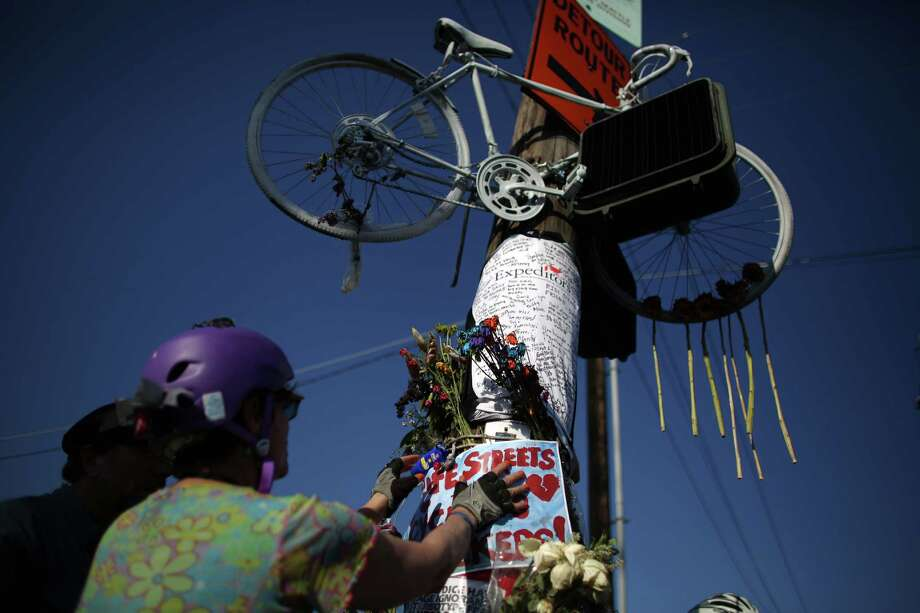 People add to a memorial during a bike ride in honor of Lance David, a cyclist killed in an accident with a semi-truck. Photo: JOSHUA TRUJILLO, SEATTLEPI.COM / SEATTLEPI.COM