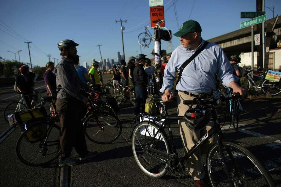 Seattle Mayor Mike McGinn participates in a memorial bike ride for Lance David, a cyclist killed in an accident with a semi-truck on East Marginal Way South near South Hanford Street. Photo: JOSHUA TRUJILLO, SEATTLEPI.COM / SEATTLEPI.COM