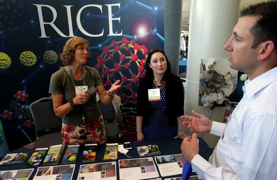 Dagmar Beck, left, and Ginny Whitaker, both with Rice University, talk Tuesday with David Slupe at the Offshore Technology Conference. Photo: Cody Duty, Staff / © 2013 Houston Chronicle