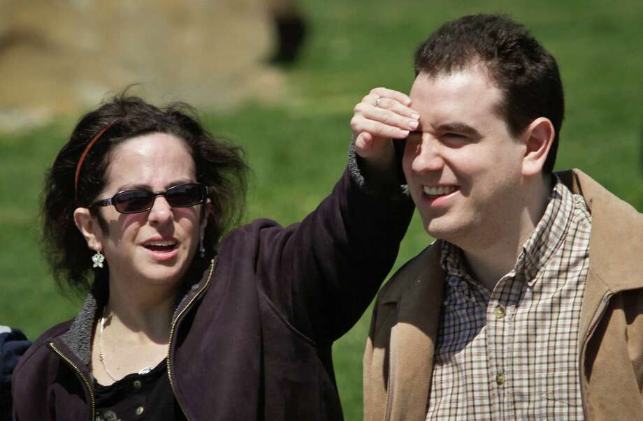 Hava Samuels, left, reacts playfully with her husband Paul Farziano as they visit a park on Thursday, April 25, 2013 in Port Jefferson, N.Y.  The developmentally disabled couple brought a lawsuit against the group facilities where they live for violating the Disability Act, by refusing them residence as a married couple.  (AP Photo/Bebeto Matthews) Photo: Bebeto Matthews