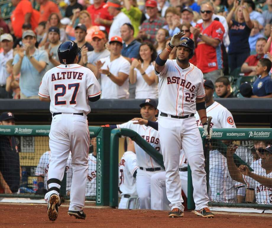 Astros catcher Carlos Corporan congratulates Jose Altuve on his home run during the first inning. Photo: Karen Warren, Houston Chronicle