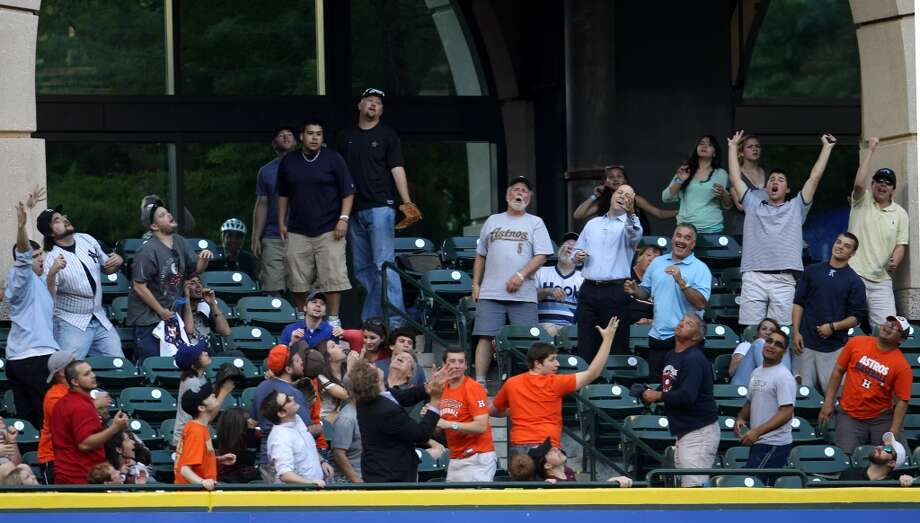 Fans react after Jose Altuve of the Astros hit a home run in the first inning. Photo: Karen Warren, Houston Chronicle