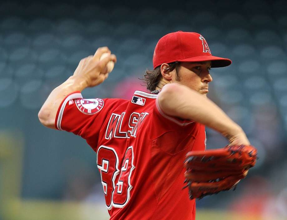 Angels pitcher C.J. Wilson makes a throw to the Astros.