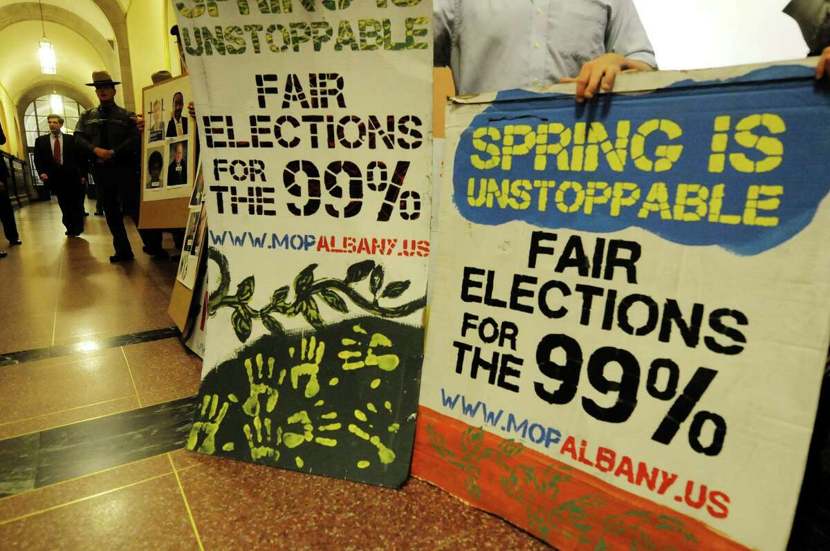 Protestors stand outside a legislative hearing on public financing in New York City elections at the Capitol on Tuesday, May 7, 2013 in Albany, NY. (Paul Buckowski / Times Union)