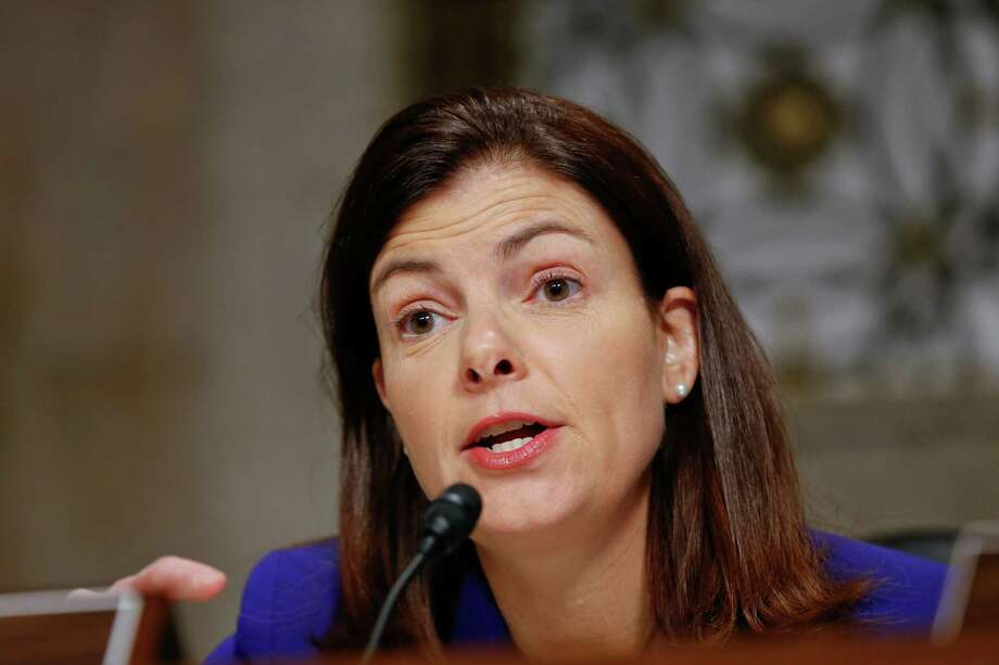 FILE - In this Jan. 13, 2013, file photo, Senate Armed Services Committee member Sen. Kelly Ayotte, R-N.H., speaks at a hearing on Capitol Hill in Washington. Gun control forces are targeting Sens. Ayotte, Max Baucus and others as they struggle to persuade five senators to switch their votes and revive the rejected effort to expand background checks to more firearms buyers. (AP Photo/J. Scott Applewhite, File) Photo: J. Scott Applewhite