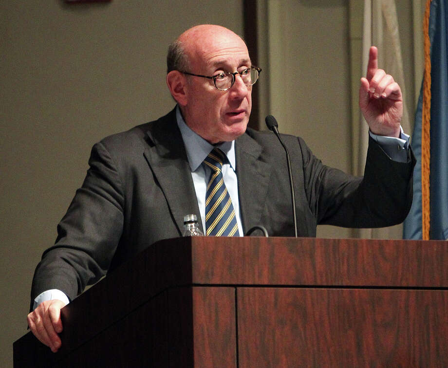 One Fund Boston administrator Kenneth R. Feinberg leads a town hall meeting held to discuss how victims of the Boston Marathon bombing will be compensated, Tuesday, May 7, 2013 at the Boston Public Library in Copley Square. (AP Photo/Boston Herald, Angela Rowlings, Pool) Photo: Angela Rowlings