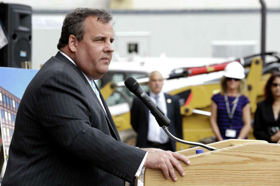 New Jersey Gov. Chris Christie addresses the media during the groundbreaking ceremony for TEAL Center at Essex County Newark Tech, Tuesday, May 7, 2013, in Newark, N.J. Reports say Christie secretly underwent a weight-loss surgery in February, when a band was placed around his stomach to restrict the amount of food he can eat. (AP Photo/Julio Cortez) Photo: Julio Cortez