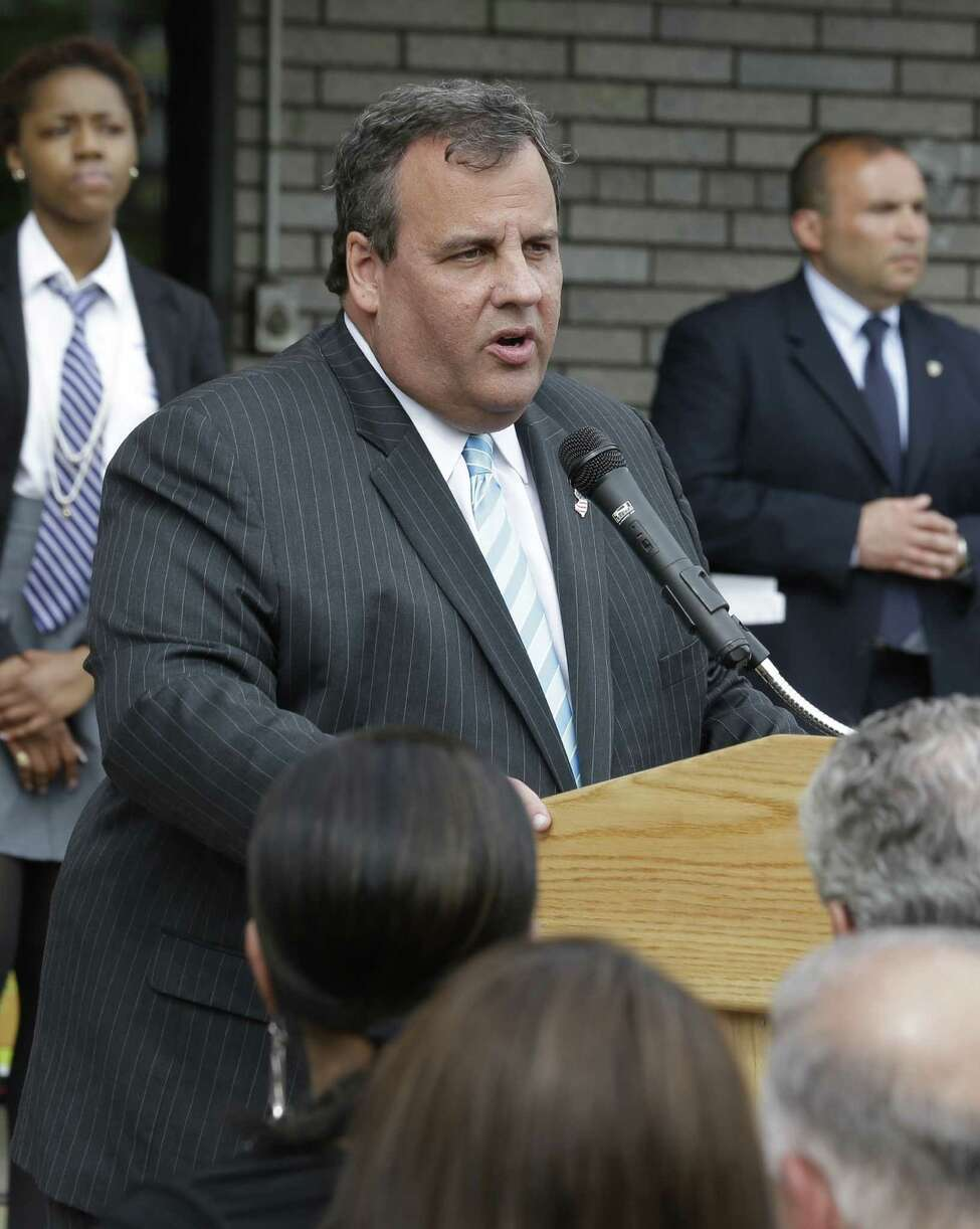 New Jersey Gov. Chris Christie addresses the media during the groundbreaking ceremony for TEAL Center at Essex County Newark Tech, Tuesday, May 7, 2013, in Newark, N.J. Reports say Christie secretly underwent a weight-loss surgery in February, when a band was placed around his stomach to restrict the amount of food he can eat. (AP Photo/Julio Cortez)
