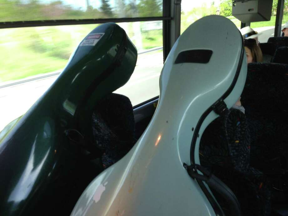 Two cellos on the bus ride down from Albany to New York City for the Albany Symphony Orchestra's May 7, 2013, performance at Carnegie Hall. (Amy Biancolli / Times Union)