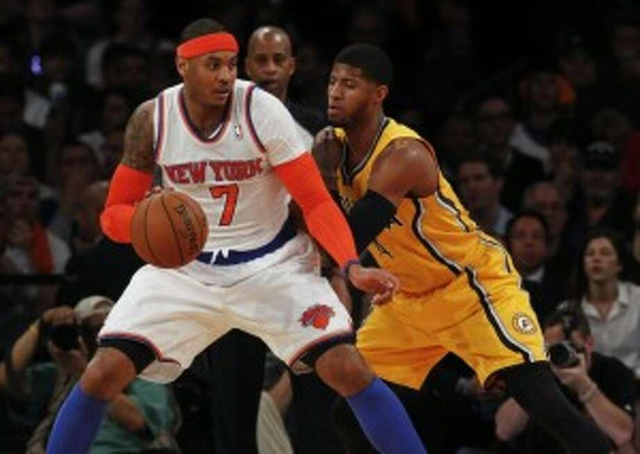 Knicks forward Carmelo Anthony led all scorers with 32 points, helping New York tie its series with the Indiana Pacers. (Jeff Zelevansky/Getty Images)