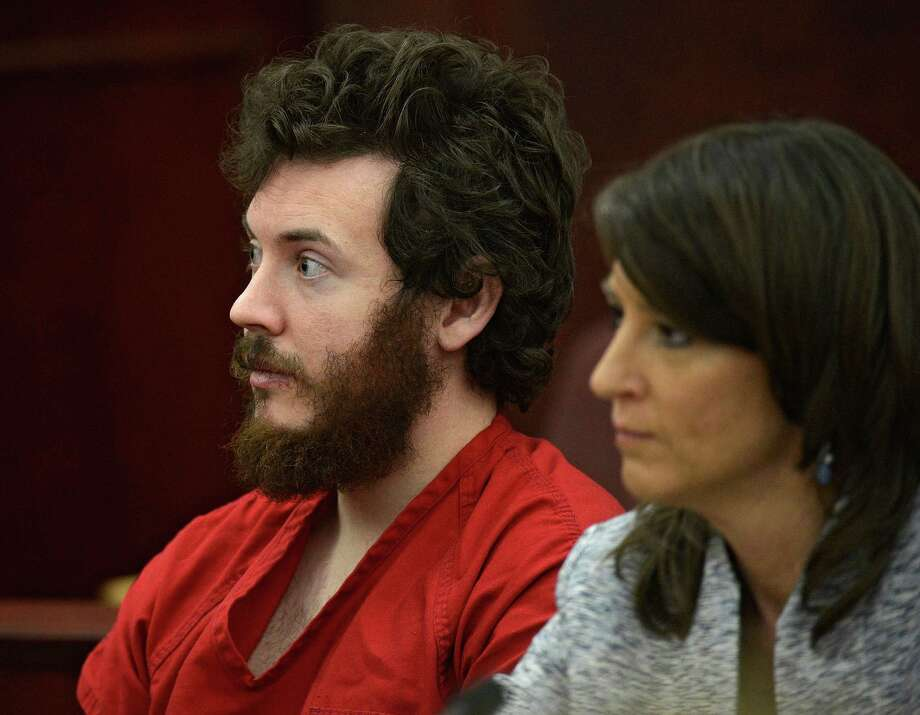 FILE - In this March 12, 2013 file photo, James Holmes, left, and defense attorney Tamara Brady appear in district court in Centennial, Colo. for his arraignment. Lawyers for Holmes, the man accused of killing 12 people and injuring 70 in a Colorado movie theater, said Tuesday May 7, 2013 he wants to change his plea to not guilty by reason of insanity. (AP Photo/The Denver Post, RJ Sangosti, Pool, File) Photo: RJ Sangosti