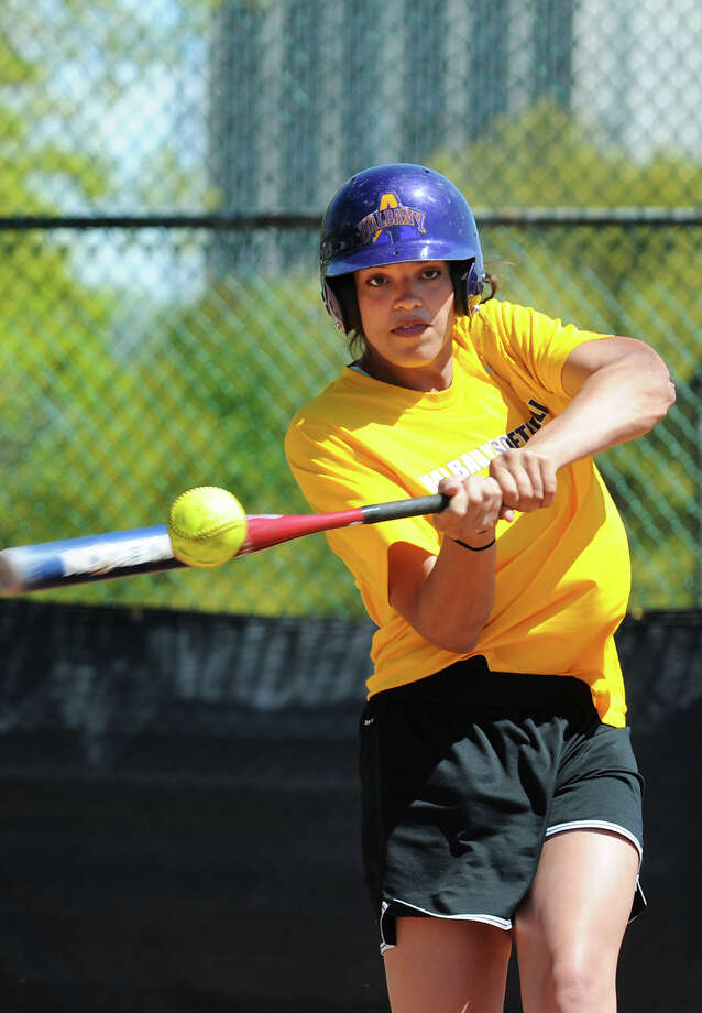 UAlbany junior Charlise Castro connects with the ball during softball practice on Tuesday, May 7, 2013, at UAlbany in Albany, N.Y. (Cindy Schultz / Times Union) Photo: Cindy Schultz / 00022311A