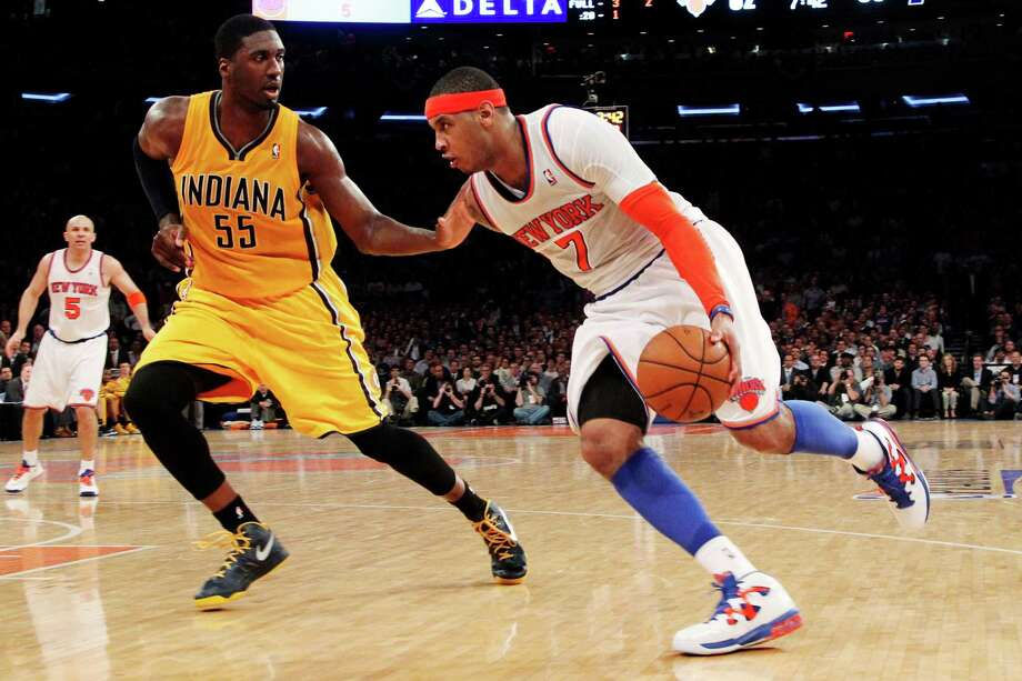 New York Knicks' Carmelo Anthony (7) drives past Indiana Pacers' Roy Hibbert (55) in the second half of Game 2 of their NBA basketball playoff series in the Eastern Conference semifinals at Madison Square Garden in New York, Tuesday, May 7, 2013. The Knicks won 105-79. (AP Photo/Mary Altaffer) Photo: Mary Altaffer