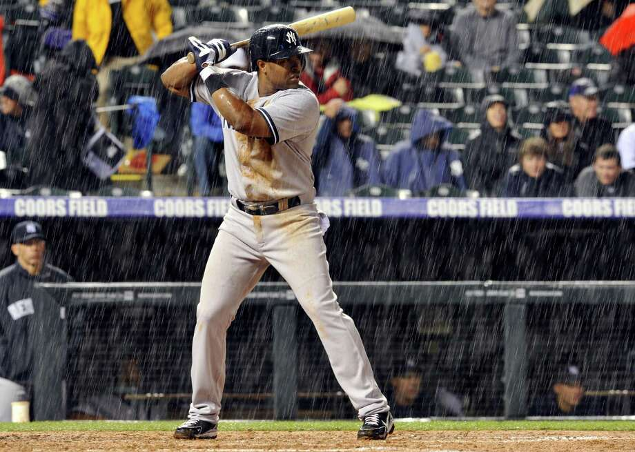 New York Yankees' Chris Nelson bats in the pouring rain against the Colorado Rockies during the fifth inning of a baseball game on Tuesday, May 7, 2013, in Denver. (AP Photo/Jack Dempsey) Photo: JACK DEMPSEY
